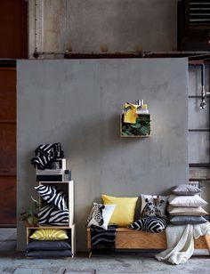 Kaksi keltaista tyynyä riittää tuomaan harmaan ja vaalean sävyihin todellista energiaa.