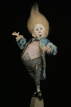 Tine Kamerbeek -- started making dolls in the sixties. Her favorites are fairy tale characters such as elves and trolls. Her first dolls were made of cotton wool soaked in wallpaper paste, since no self-hardening clay existed, Now she uses Japanese Paperclay or Formo Fit.