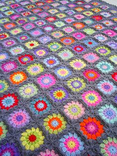 circle in a square granny blanket by riavandermeulen, via Flickr