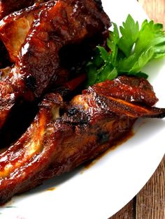 Oven baked country style pork ribs are slow-cooked to fall-off-the-bone perfection. Sauce recipe included. #country #Rib #Recipes #Oven #KitchenDreaming