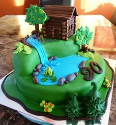 Olivia wants the pond from the other cake to replace the pond on this cake. And she wants a fox with a den on the bottom portion, and a raccoon on top. :)
