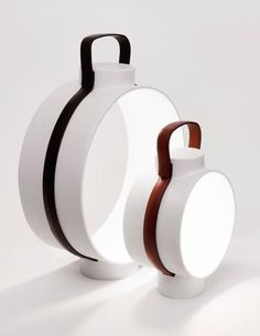 Dante Nightingale:upscale light, made with ceramic from Rosenthal, hides all the wires within leather straps that encircle it and form a handle at the top. The LEDs are out of sight, too, so the lantern seems to glow spontaneously. www.dante.lu