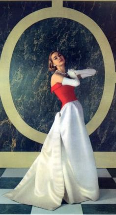 Portrait of a lady wearing a Balenciaga evening gown & white gloves, 1955