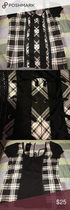 Cute Edgy Top From hot topic a while ago! The brand is Tripp NYC. Offers and questions always welcome!! Hot Topic Tops