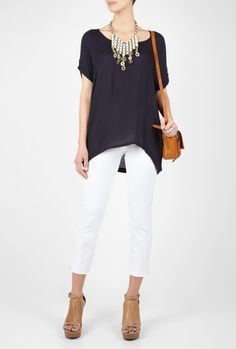 Black top, tan sandals, tan bag