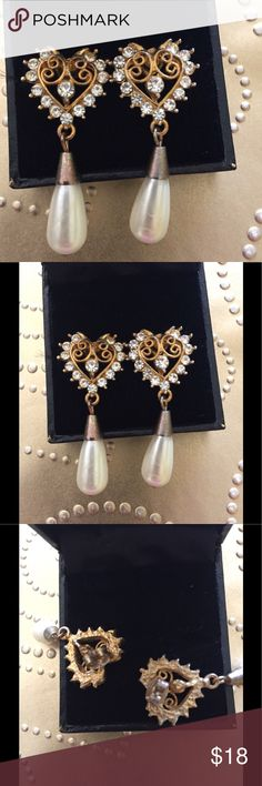 Vintage Teardrop Pearl Rhinestone Earrings These are pierced and are probably from the sixties. They are Goldtone tiny bit of tarnish from age. The pearls are faux I would imagine since this is costume jewelry. They are a beautiful pair though and are very unique. Vintage from estate sale. Please no lowball offers as I spend a lot of time and money to find these treasures for you. Jewelry Earrings