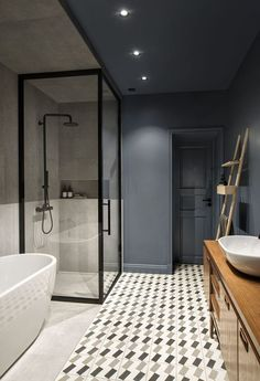 Deep colors combined with various wood textures, cement and ceramic granite tiles give a unique personality to this partment is situated in the center of Saint-Petersburg and refurbished by INT2architecture. #bathroom
