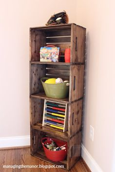 I love this idea, these crates from the local craft store, wood glue, nails, a little burn technique and stain! I would do a whole bookcase in love with the look.I would use ammo boxes instead of crates Pallet Crates, Wood Crates, Pallet Wood, Blanket Storage, Diy Casa, Home Organization, Home Projects, Diy Home Decor, Room Decor