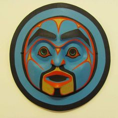 Moon Mask painted in a Bella-Bella style and carved from red cedar by the Native Master Artist Wayne Alfred from the Kwakwaka´wakw or Kwakiutl Nation.