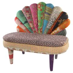 One-of-a-kind peacock loveseat made from reclaimed vintage kantha throws and mango wood framing.  Product: Loveseat
