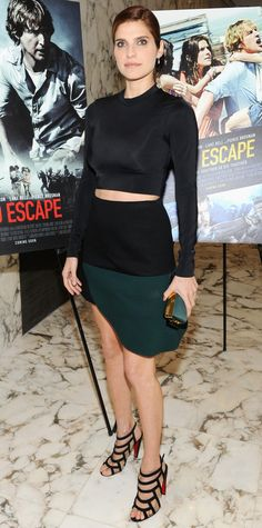 Lake Bell bared a panel of midriff at the special screening of No Escape in a black long-sleeve crop top and a forest green-and-black color-block mini. She styled her look with a matching satin green minaudier and black cage Louboutin sandals.
