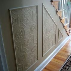 Faux Carved Wainscoting using textured wallpaper****didnt know if you knew about plain white textured wall paper. It's spendy, but looks really cool when you paint it. Would def look good on a wall in your bedrm or bathrm to make them a little more luxurious