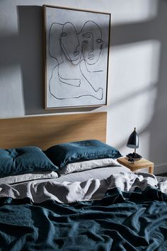 Like pared back, minimal bedroom styling? Layer linen sheets in cool tones such as our Petrol and Fog.