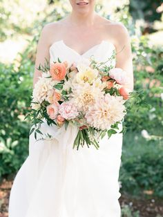This bouquet should be a painting! Soooo pretty! Floral Design: Sweet Marie Designs | Photography: Ashley Kelemen | See the wedding on Style Me Pretty: http://www.StyleMePretty.com/2014/02/26/elegant-del-mar-garden-wedding/