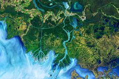Winds Trigger Pond Growth : Image of the Day : NASA Earth Observatory