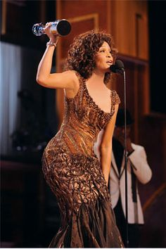 The american singer Whitney Houston wearing a Tony Ward Couture gown at the BET Honors