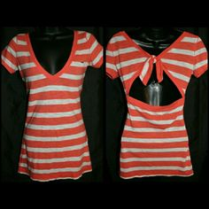 Hollister Striped Keyhole Top XS So cute! Coral sherbert orange & white striped v-neck tee. Bow tie keyhole back.  By Hollister. Size Extra Small. Cotton/polyester blend. Pre-owned. No holes, rips, or stains.    Measurements & additional photos upon request   BUNDLE & SAVE! 15% off 2 or more items!   ID: A09 Keywords: spring, summer, preppy, low cut, cleavage, indie, boho, ootd Hollister Tops Tees - Short Sleeve