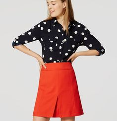 Roll tab sleeves give this refined essential its modern attitude. Collared. Long sleeves. Button front. Button through flap patch pockets. Button-through roll tabs at sleeves. Button cuffs. Shirttail hem. Gathered beneath back yoke.