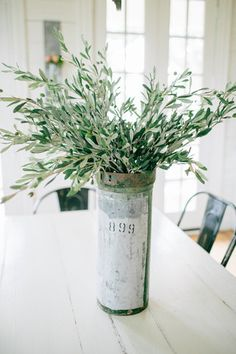 This Olive Stem | The Magnolia Market filled with random nails, screws, and metal parts is great for decorating with the 'metal' Feng shui element, and the pretty stems hide the ugly nails and screws underneath!