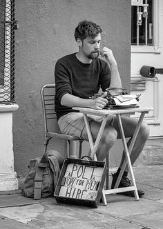 Poet For Hire Bw.  Antoine is from France and has opened his own creative business on the streets of the French Quarter of New Orleans. I think he is using the world's oldest typewriter!