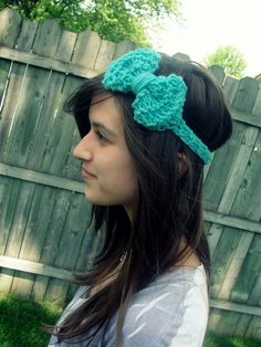 Hand knitted bow headband that my lovely friend Kristy makes. Visit her Esty shop!