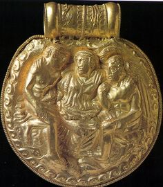 Etruscan gold bulla with cintamani, 4thc BC, Vatican Museum    		This medallion was found in a tomb at Vulci.