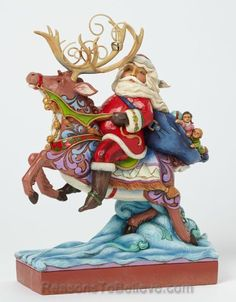 Santa Riding Reindeer - Next Stop The Rooftop | Santa Claus Figurines and Hand Carved Wooden Santas