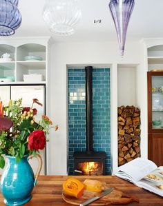 I NEED THE JUG AND TILES White Modern Kitchen with Blue Tiled Alcove and Woodburning Stove