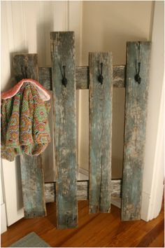 Pallet (I think) pieces repurposed into pickets w/ hooks - cute