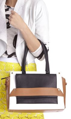 Black, cognac & white colorblocked satchel with top handles, a removable crossbody strap and top zipper closure