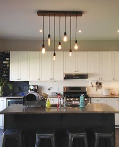 "Kitchen Lighting - 7 Pendant Wood Chandelier  All Chandeliers are custom and handmade to order any way you like. Just leave a note during checkout to specify your custom options! See listing photos for all available choices. Includes 7 Pendants in any custom colors and choice of wood base. Default as pictured 35"" x 9"" reclaimed Wood (more options shown in photos)  BULBS: Bulb pricing shown in options drop down menu. Choice to include a mix of antique style Edison bulbs, NEW LED bulbs, or…"