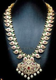Beautiful contemporary pachi work traditional mango mala with small emeralds, flat diamonds and rubies all over. Indian Jewelry Sets, India Jewelry, Mango Mala Jewellery, Temple Jewellery, Emerald Jewelry, Diamond Jewellery, Beaded Jewelry, Bollywood Jewelry, Bollywood Fashion