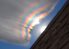 Unique rainbow in clouds