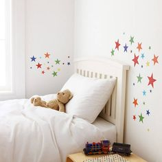 Bright harlequin patterned Star Wall Stickers for Kids Rooms containing 50 stars. £13.75