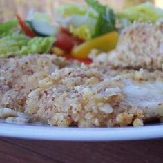 Tilapia is coated with ground almonds and Parmesan cheese in this delicious dish.