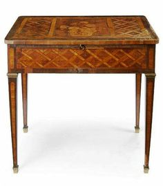 Marquetry Table, from the Wick Estate,. A louis XVI  Marquetry Inlaid Walnut Writing Table late 1700s