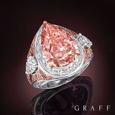 Truly unique Set within a dramatic setting of radiating white and pink diamonds, a rare and stunning 8.97 carat pear shape Fancy Vivid Pink diamond takes centre stage. #GraffDiamonds #PinkDiamond #PinkDiamondRing #FineJewellery #DiamondDesign
