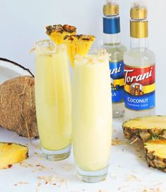 Tropical Pineapple Coconut Cooler served in a tall glass with toasted coconut around the rim, and pineapple wedge-made with Torani Syrups Coconut Syrup, Toasted Coconut, Italian Sodas Recipe, Torani Syrup, Italian Cream Soda, Cocktail Syrups, Soda Recipe, Drinks Alcohol Recipes, Punch Recipes