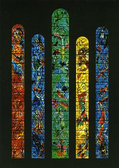 stained glass windows painted by Marc Chagall in the early 1970s depicting events from the old and new testament.
