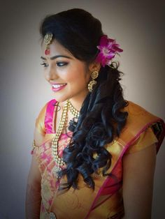 Indian bride's bridal hairstyle by Swank Studio. Find us at https://www.facebook.com/SwankStudioBangalore