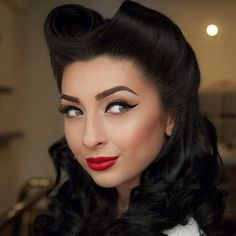 That hair! Such a perfect pin-up hairstyle.
