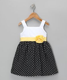 This charming frock will look smartly sweet on any little lady. Kissed with pretty polka dots, a bright waistband and blooming flower accent, this piece is one genius style choice.