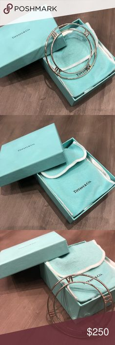 Tiffany and Co. Vintage Atlas II Bangle This vintage Tiffany Bangle is sold at a retail price of $600.00. It has never been worn and is in mint condition. Comes with original box and Tiffany pouch. Tiffany & Co. Jewelry Bracelets