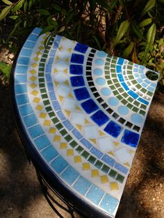 Corner mosaic side table by CareWare on Etsy, $75.00