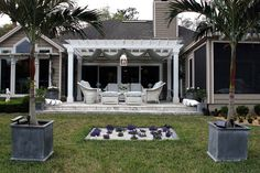 The backyard of designer Karen Robertson, featuring her own outdoor fabrics and Lloyd Flanders furniture
