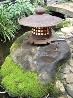 Japanese garden, create one if possible. A Japanese lantern and some plants and a small water fountain will do if you don't have a garden. Listen to soothing music, flute and harp music are calming. Some New Age music is available at your department store Japanese Garden Lanterns, Japanese Stone Lanterns, Japanese Garden Design, Japanese Landscape, Japanese Gardens, Small Water Fountain, Japan Garden, Meditation Garden, Water Garden
