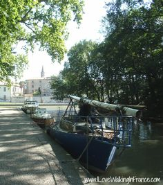 Boats moored in a quiet section of the port at Castelnaudary on the Midi Canal, France.