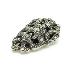 Lovely marcasite dress clip and brooch set dating from the 1930's. Dress clips were popular in the 1920's up until the 1950's and were worn around the neck of a dress or blouse to create a sweetheart neckline, changing the look of the outfit as well as a decorate adornment.   The clip is adorned with marcasite stones,  marcasite is actually Pyrite all known as Fools Gold. It was used in jewellery due to it's ability to catch the light, giving a diamond effect.   MEASUREMENTS The dress clip…