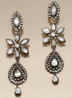 PAIR OF DIAMOND PENDENT EARRINGS, PORTUGUESE SECOND HALF OF THE 18TH CENTURY.  Each suspending a pear-shaped drop within concentric frames, to a central flower head motif, and a navette-shaped surmount, set with foil backed rose-cut diamonds, original hinged fittings, three detachable sections, original scalloped fitted case.
