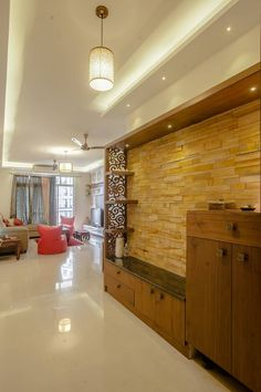 3 BHK partement : Living room by In Built Concepts unit design With Stone Cladding Living room design ideas, interiors & pictures Living Room Partition Design, Room Partition Designs, Living Room Tv Unit Designs, Tv Wall Design, Hall Design, Door Design, Stair Landing Decor, Home Entrance Decor, Entrance Foyer